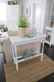 whitewash wood furniture. super cute mutliuse diy table with spindle legs and a beachy coastal style whitewash wood furniture