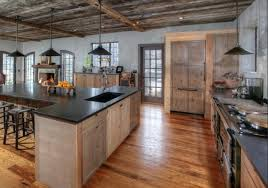 farmhouse kitchen industrial pendant. located in a new jersey home this kitchen features handhewn beams leaded glass windows and reclaimed american chestnut floor boards farmhouse industrial pendant