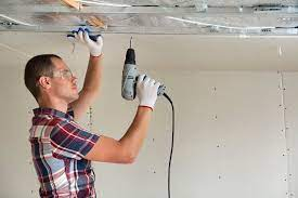 how much to charge to hang drywall