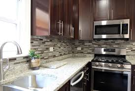 contemporary kitchen with glass mosaic backsplash and dark color cabinets