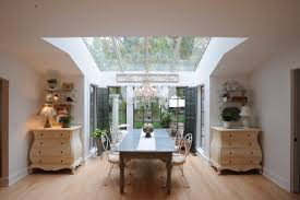 dining room chests. marble-dining-table-with-white-chairs-and-chandelier- dining room chests