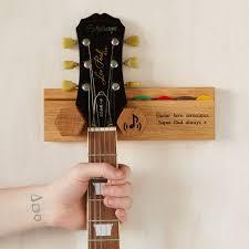 personalised solid oak guitar wall stand by mijmoj design