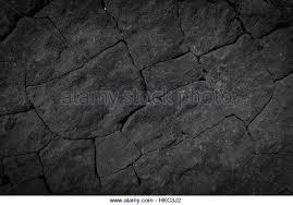 black stone wall texture. Dark Grey Black Wall Stone Background Or Texture -lava - Stock Image