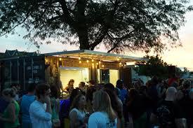 sunset at larkin beer garden on a busy summer night