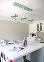 if you re considering lining up pendants over an island or table keep in mind the rule of three a row of three lights is much more pleasing to the eye