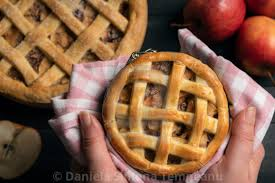 Homemade Apple Pie Held In Hands Above View Kitchen Table With