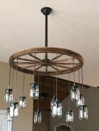 wagon wheel chandelier mason jars alternating length wagon wheel mason jar