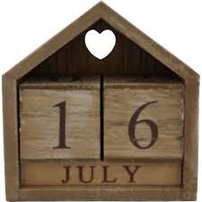 natural wooden perpetual calendar with cut out heart detail wallpaper warehouse