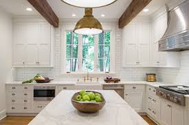 this gorgeous white kitchen designed by kitchens unlimited is simply breathtaking