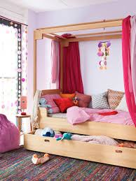 wooden round bedside table in wonderful contemporary kids room ideas with canopy bed and decorative pillows