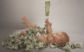 Baby playing with dollar bills