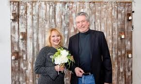 ever after co owners cyndy hoenig and dave dumay pose as a married couple inside