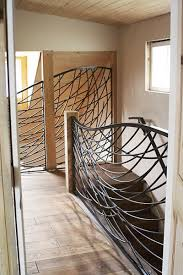 Stonetree Studios Wrought Iron Railing contemporary-staircase