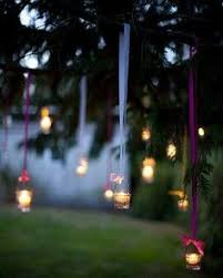 diy wedding lighting. diy lighting tealight candles dangled from shades of purple ribbon among the trees surrounding melody and adamu0027s wedding venue as reception progressed diy