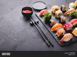 Powerpoint Template Sushi And Rolls Background Frame On Black Top
