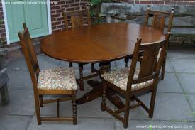 an old charm wood brothers light oak round pedestal kitchen dining table 4 dining chairs