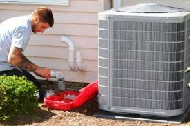 35 ton ac unit cost. Simple Cost HVAC Technician Kneeling On Ground While Performing Maintenance Ac Unit For 35 Ton Ac Unit Cost