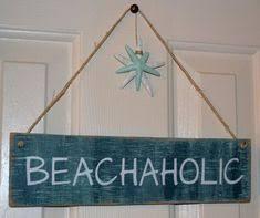 wooden beach hut plaques coastal signs of sea level dan word