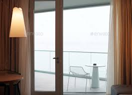 living room with glass door to balcony sea view stock photo images