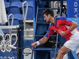 Novak Djokovic throws and smashes ...
