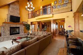 Nice Ranch Living Room With Fireplace And High Ceiling With Chandelier