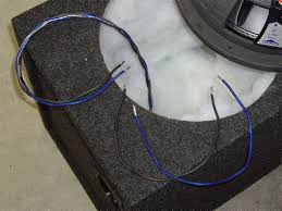 how to wire a dual 4 ohm subwoofer in parallel for a 2 ohm load 6 cut and prepare the speaker wire