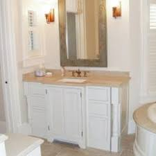 white bathroom cabinets with bronze hardware. bronze fixtures spice up traditional white bathroom cabinets with hardware b