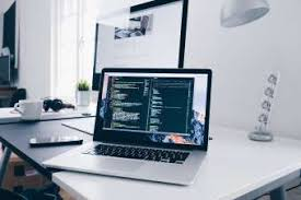 hd wallpapers office. HD Wallpaper Code On A MacBook Laptop In Minimal Office Hd Wallpapers