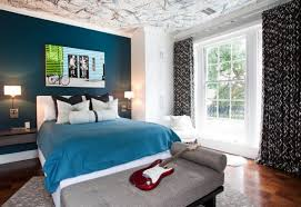 ... Splatter painted ceiling in three different colors enlivens the boys'  bedroom
