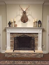 deer stone fireplace mantle stained concrete floors basement traditional mantle