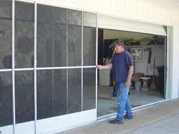 large size of garage doors garage screen door rollers with roll down patio repair in