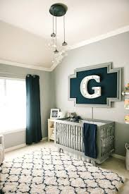 modern grey navy and white nursery round rug