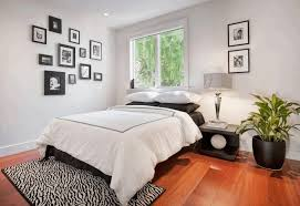 bedroom black and white themed bedroom decorating ideas exquisite glass chandelier cozy beige ottoman smooth
