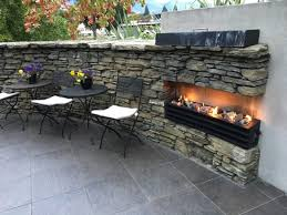 queenstown park boutique hotel hotel outdoor gas fireplace right at the entrance