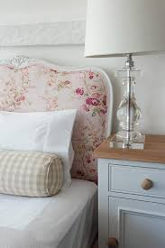 pink shabby chic bed with gingham bolster pillow