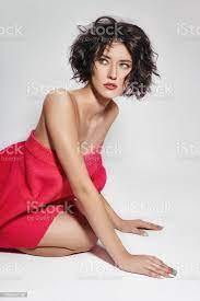Naked Sexy Woman With Short Hair Girl Posing In A Red Sweater On A White Background Perfect Clean Skin Sexy Nude Body Of Brunette Woman Skin Rejuvenation And Hydration Stock Photo