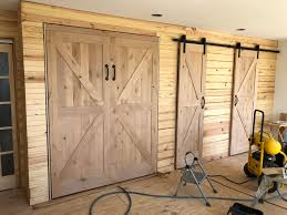 finished out a murphy bed in knotty alder to match the barn doors in a customers addition