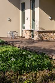 composite decking softens a concrete porch with style