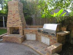 image of prefab outdoor kitchen and fireplace