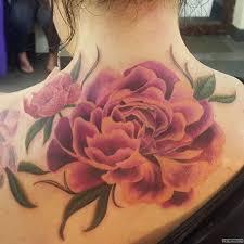 большой цветок пиона тату на спине у девушки добавлено иван