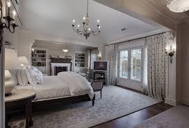 traditional master bedroom with chandelier by the corcoran group safavieh california cozy plush beige