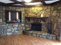 rustic interior stone rock fireplace castle style living room