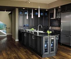 dark kitchen cabinets wall color white gloss island with white granite top beige wooden laminate flooring