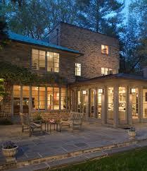 Sunroom addition on 1930s modern stone cottage Architecture