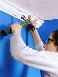 diy crown molding tips never use a hammer like this she s an use an air nail gun