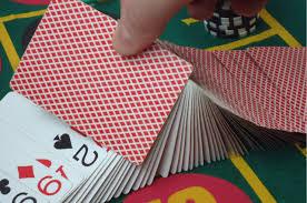 dealer shuffling deck