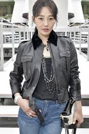 bai bai he chanel ambassador wore a black leather jacket look 22 from the paris cosmopolite 2016 17 collection with a black top from the 2016 2017