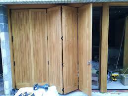 folding garage doorsFolding garage doors in central London  Bespoke Driveway Gates