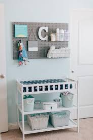 Pegboard above Changing Table for Storage - looks great and is functional!  Love this nursery