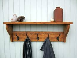 wall mounted shelf with hooks wall shelf with mirror and hooks coat racks stunning mounted coat